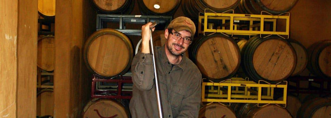 Winemaker Emmett Reed does manual punchdowns in our cellar