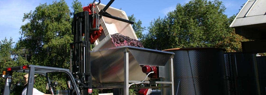 Post-fermentation, the juice and skins are loaded into the press